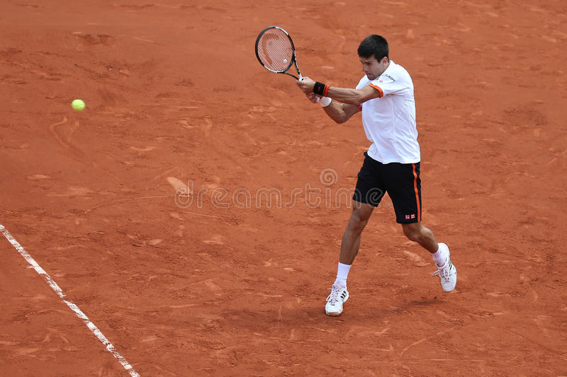 Eight times Grand Slam champion Novak Djokovic in action during his third round match at Roland Garros. PARIS, FRANCE- MAY 30, 2015: Eight times Grand Slam stock photo