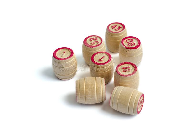 Eight wooden barrel numbers for a lotto game. On a white background royalty free stock photo