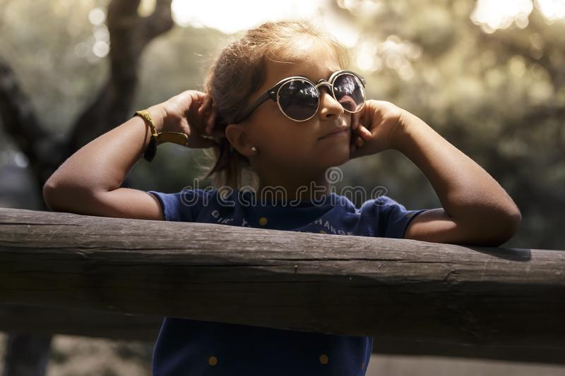 Eight year old girl posing in park royalty free stock images
