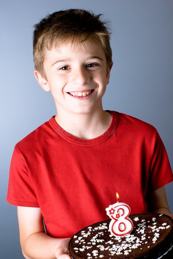 Eight years birthday. Smiling child with birthday cake stock images