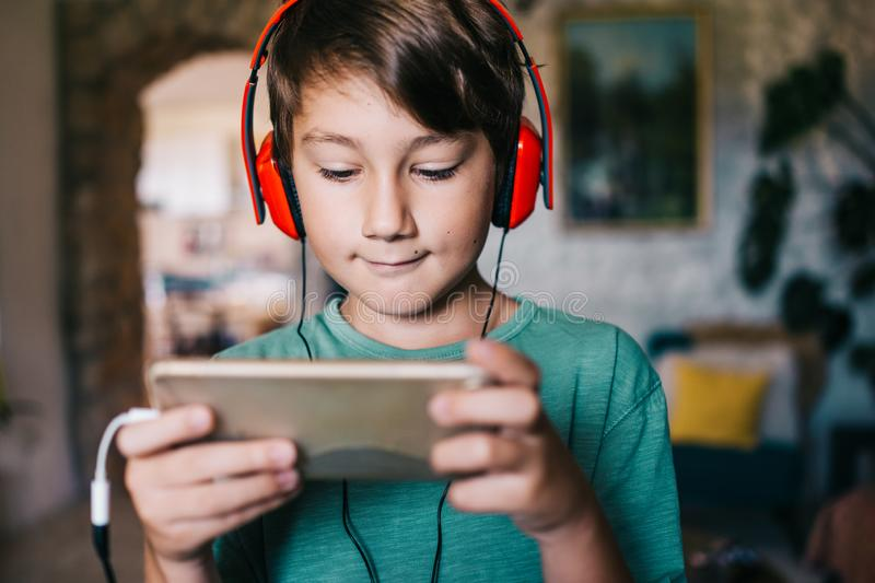 Eight years old boy playing game royalty free stock images