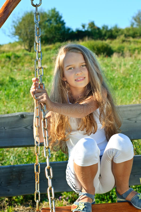 Eight years old girl. Eight years old long hair girl posing outdoors stock images