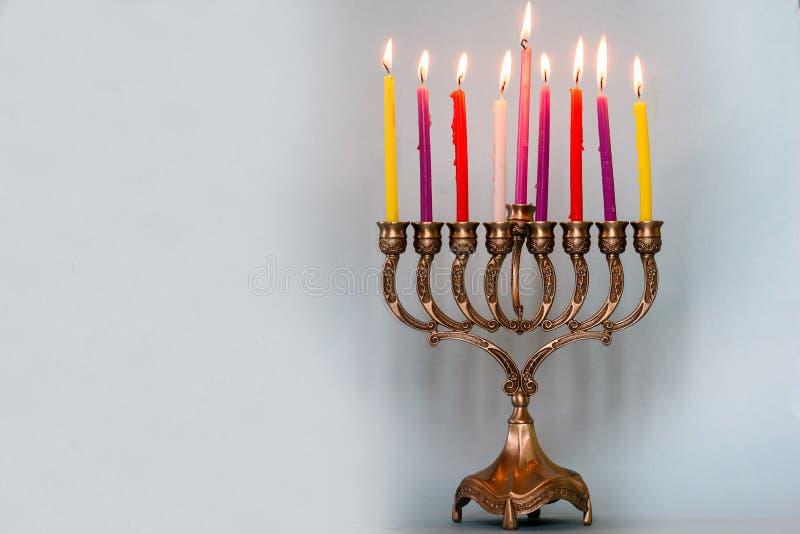 Eighth day of Hanukkah with burning Hanukkah colorful candles in Menorah. Eighth day of Hanukkah with burning Hanukkah colorful candles in Menorah traditional stock photos