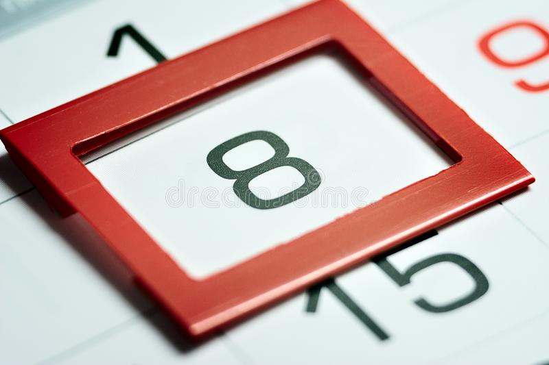 Eighth day of the month. Highlighted on the calendar with a red frame close-up macro, mark on the calendar, eighth date stock image
