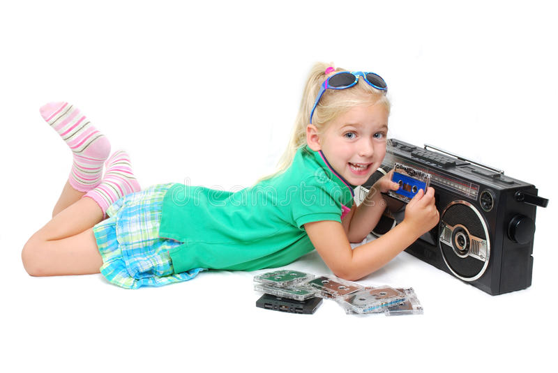 Eighties Kid. Little girl with radio and music cassettes