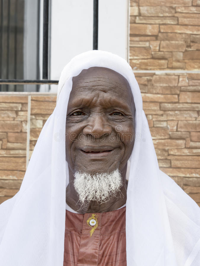 Eighty-year-old African man smiling in the street royalty free stock photo