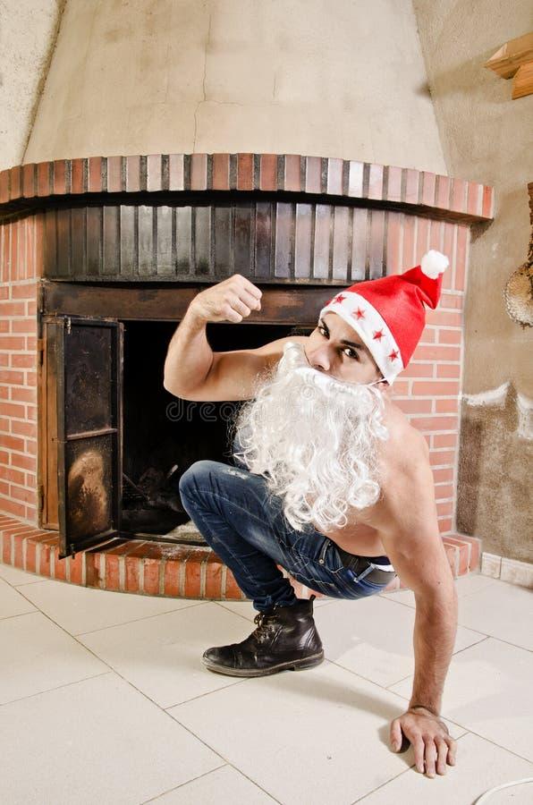 Eignung Santa Claus aus dem Kamin heraus stockfotografie