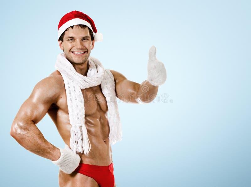 Eignung sexy Santa Claus im weißen Schal, Lächeln, auf blauem backgro stockfotos