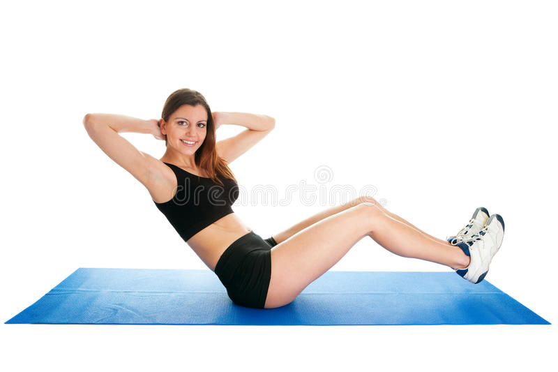 Eignungfrau, die Aerobics auf Gymnastikmatte tut stockbilder