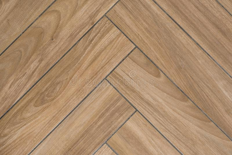 Eiken houttextuur die van vloer met tegels hardhoutbevloering imiteren Traditioneel visgraatpatroon stock afbeelding