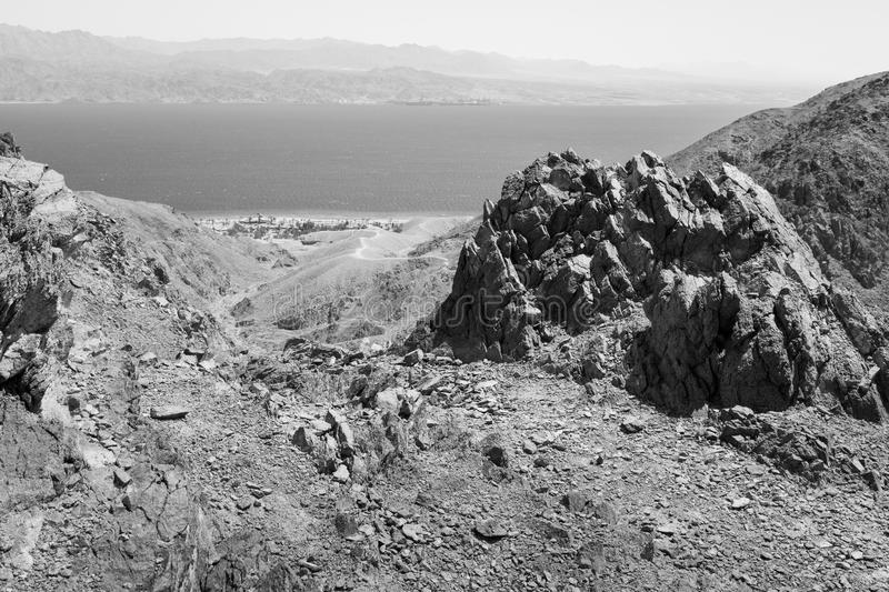 Eilat and Aqaba mountains and Red sea view B&W. Black and white Red sea mountains and Eilat Aqaba city view, Israel royalty free stock photos
