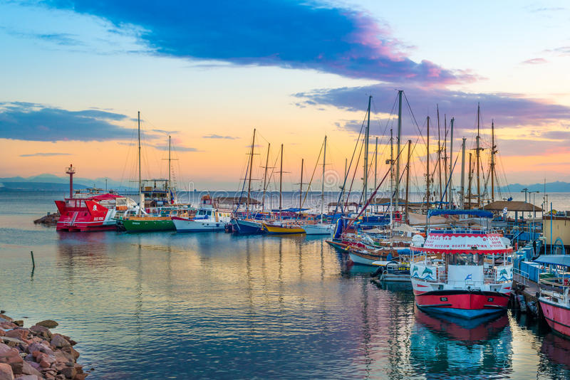 Eilat bay. Colorful boats docking in Eilat Bay, Israel royalty free stock photo