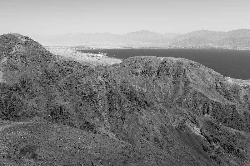 Eilat city harbor and mountains , Aqaba, and Red sea view B&W. Black and white Red sea mountains and Eilat Aqaba cityies view, harbor seaport, Israel royalty free stock photography