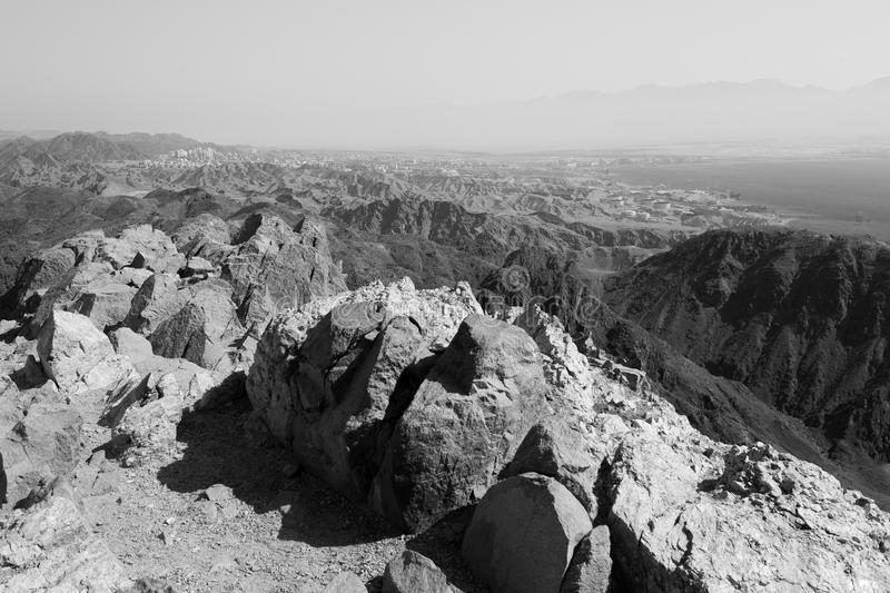 Eilat city mountains and Red sea view B&W. Black and white Red sea mountains and Eilat city view, Israel stock photo