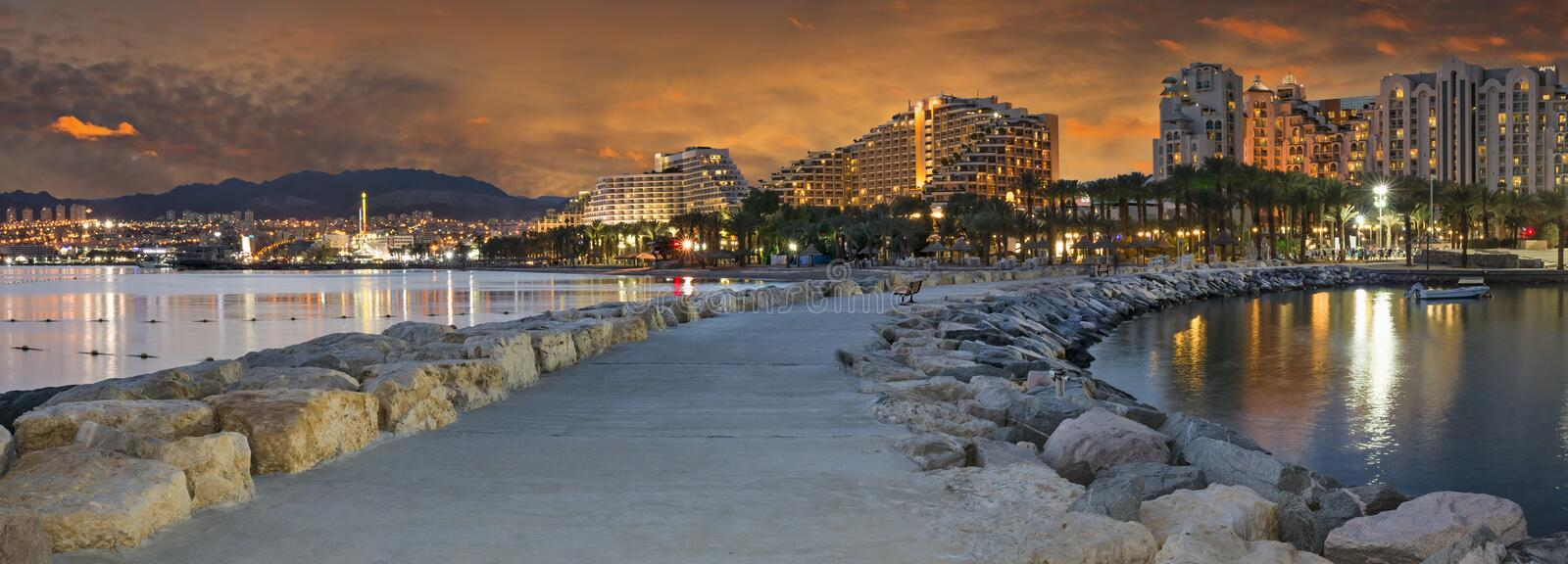 Night panoramic view from a public walking pier in Eilat, Israel stock photos