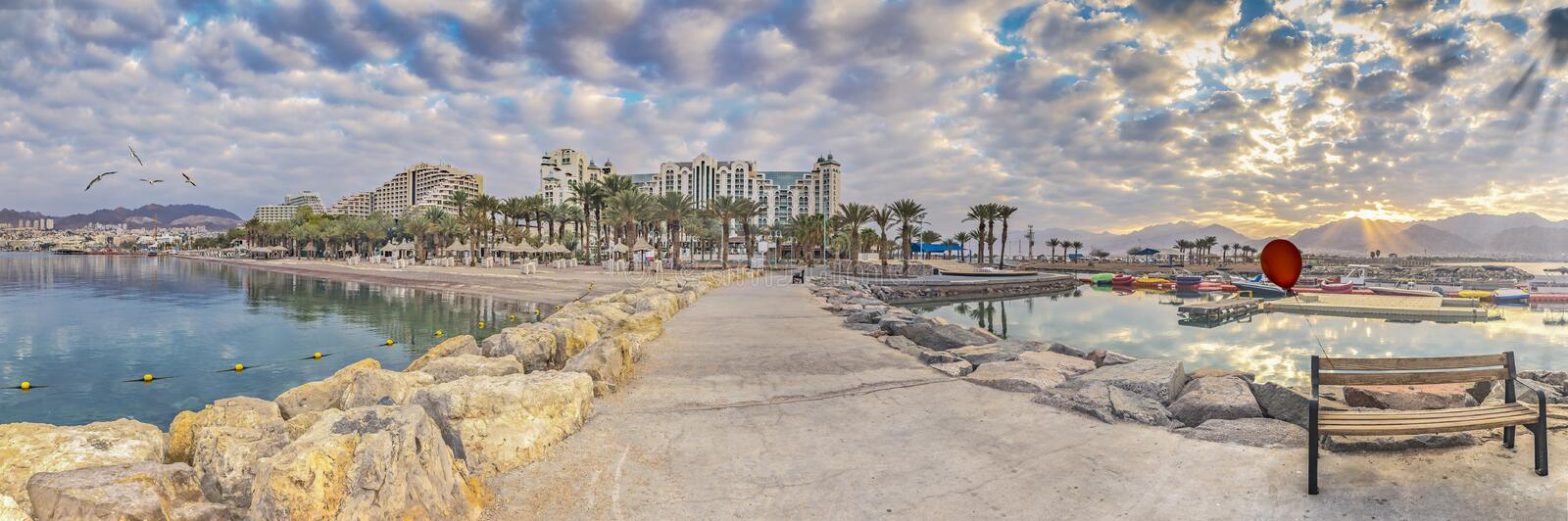 Morning at central public beach in Eilat, panorama. Eilat is a famous tourist resort and recreational city in Israel stock image