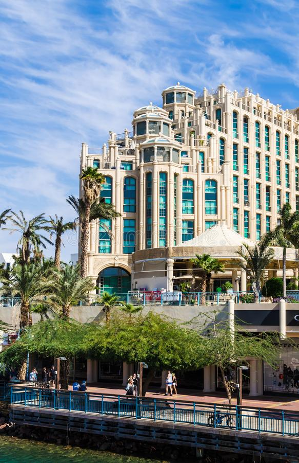 EILAT, ISRAEL – November 7, 2017: The entrance to the Marina with the promenade and Hilton Hotel Complex on the background. EILAT, ISRAEL – royalty free stock photography