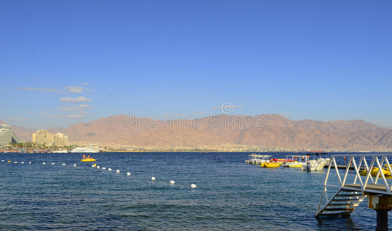 EILAT, ISRAEL - APRIL 11, 2011. Central public beach in Eilat - famous resort city in Israel stock photo