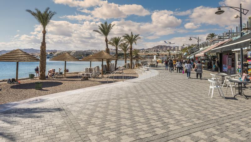 EILAT, ISRAEL - JANUARY 15, 2018: Central public beach and promenade in Eilat. Eilat is a famous serene location that is very popular tropical getaway for royalty free stock photo