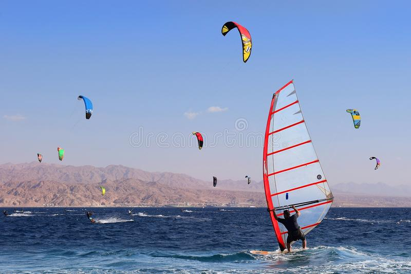 View of a windsurfer in the gulf of Eilat, Red Sea, Eilat, Israel. Eilat, Israel - october 17: view of a windsurfer in the gulf of Eilat, Red Sea on october 17 royalty free stock image