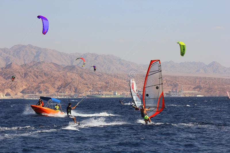 Windsurfers in the gulf of Eilat, Red Sea, Eilat, Israel. Eilat, Israel - october 17: view of a windsurfer in the gulf of Eilat, Red Sea on october 17, 2017 in royalty free stock image