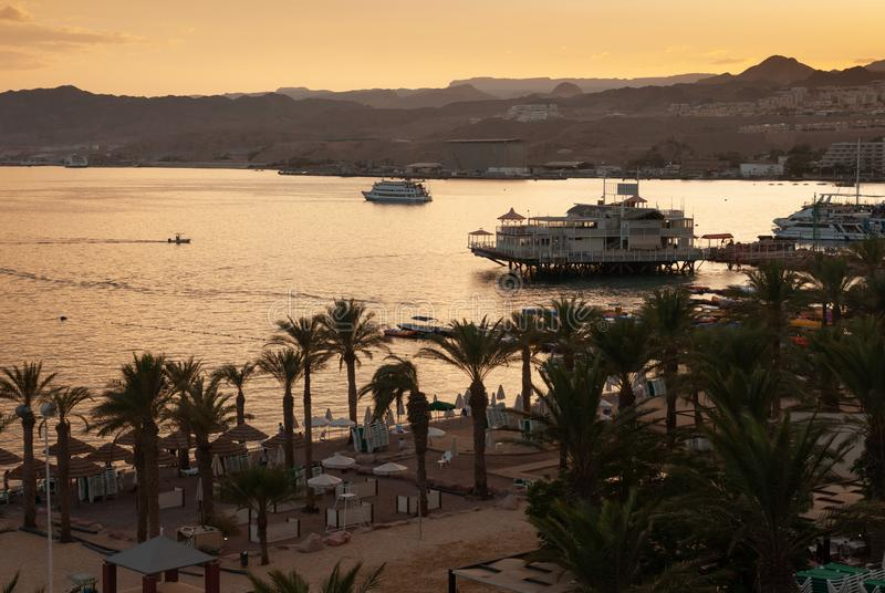 Amazing golden sunset at Eilat Red Sea bay. EILAT, ISRAEL - SEPTEMBER 24, 2011: Amazing golden sunset at Eilat Red Sea bay stock photography