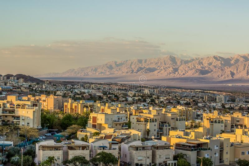 Eilat Israeli city in Middle East Gulf of Aqaba region urban landmark view small living buildings and desert mountain ridge. Background landscape picturesque royalty free stock photography