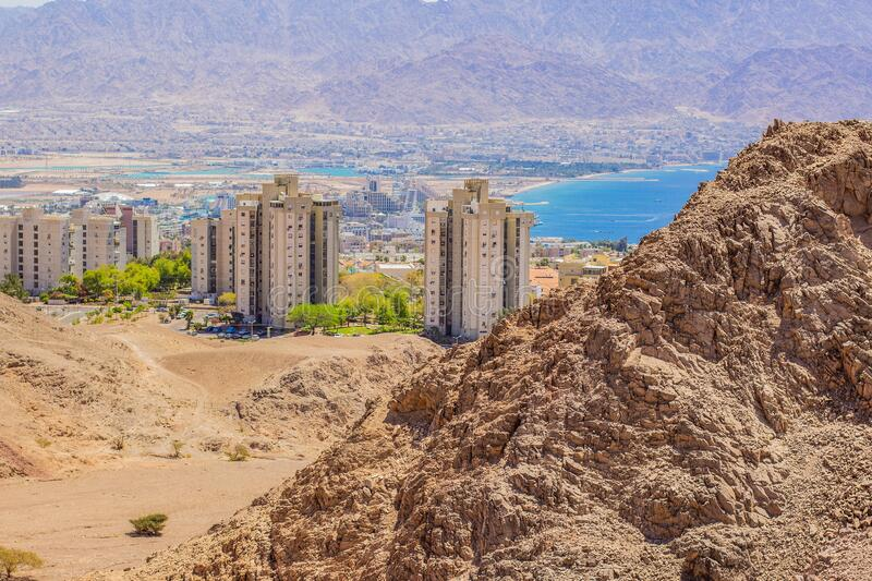 Eilat Israeli desert city Gulf of Aqaba Middle East region landmark urban buildings view from sand stone wilderness rocky. Mountains outskirts nature space stock photos