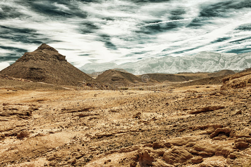 Eilat mountains at Timna Park HDR. The Eilat monuntains, Negev Desert, at Timna National Park, Israel HDR image with black gold filter royalty free stock photos