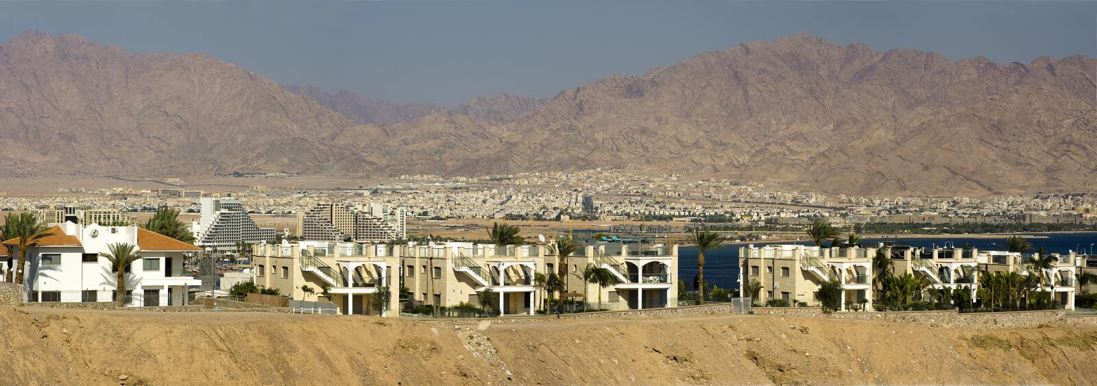 Eilat. Panorama of houses in Eilat and Aqaba in the background stock photo
