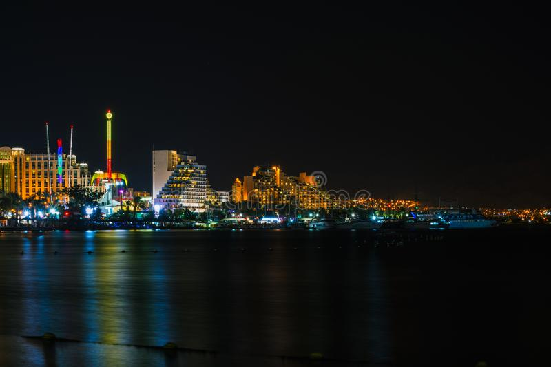 Eilat at warm summer night. During vacation on the Red sea shore in wellknown resort stock photo