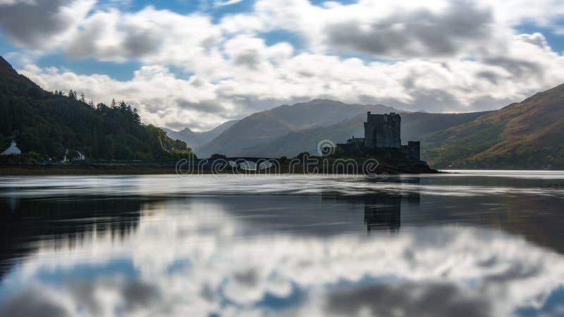 Eilean Donan Castle Scotland landmark Scottish old fortress. Medieval lake bay bridge beautiful view long exposure reflection royalty free stock images