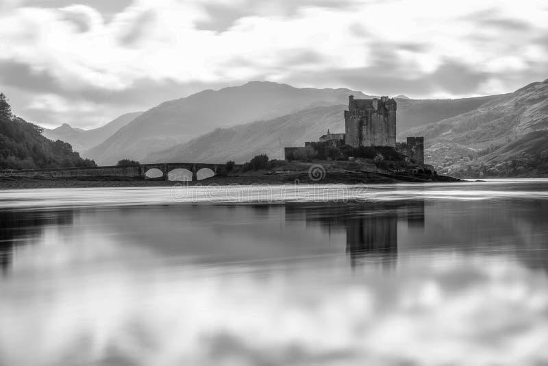 Eilean Donan Castle Scotland landmark Scottish old fortress. Medieval lake bay bridge beautiful view long exposure black and white stock photography