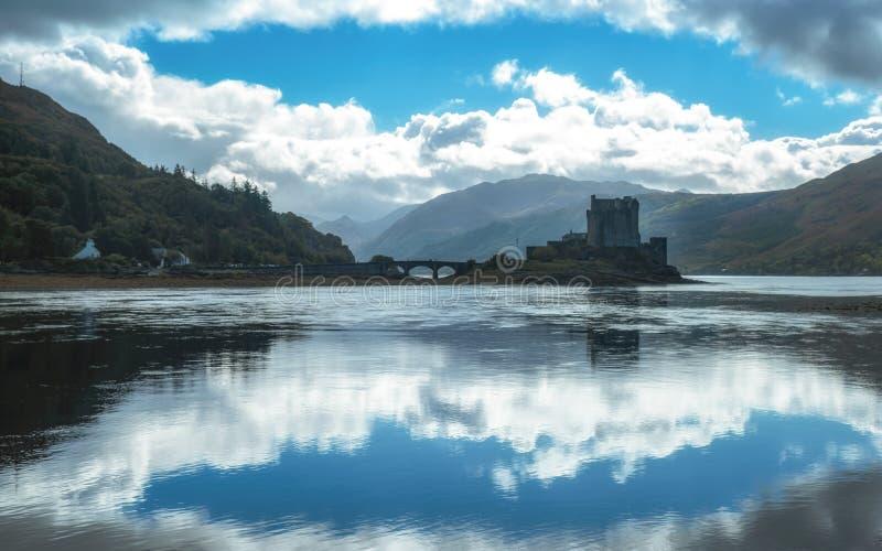 Eilean Donan Castle Scotland landmark Scottish old fortress. Medieval lake bay bridge beautiful view long exposure reflection royalty free stock photo