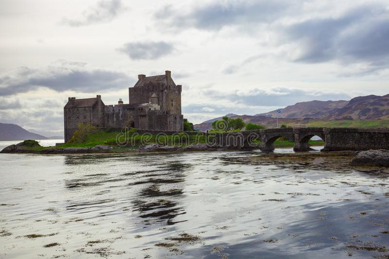 Eilean Donan Castle in the Scottish Highlands under cloudy sky stock images