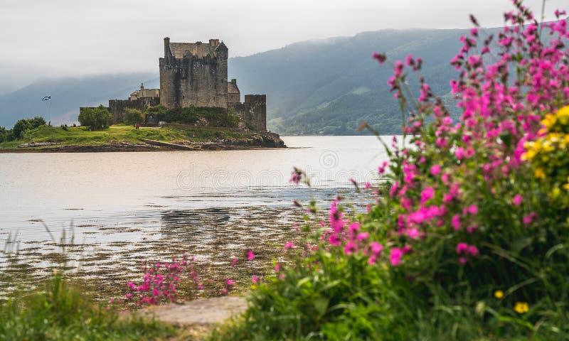 Eilean Donan castle among scottish mist, Scotland, UK. royalty free stock photography