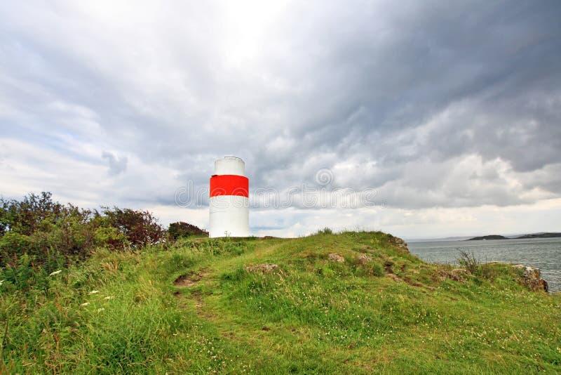 Ein alter Leuchtturm an den silbernen Sanden lizenzfreie stockfotografie