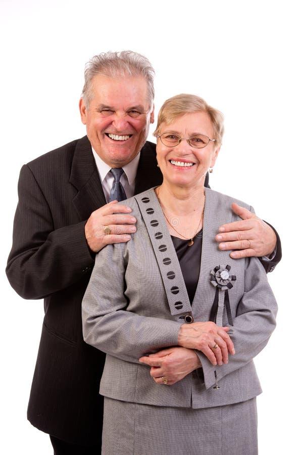 Ein altes älteres Paarlächeln stockbild