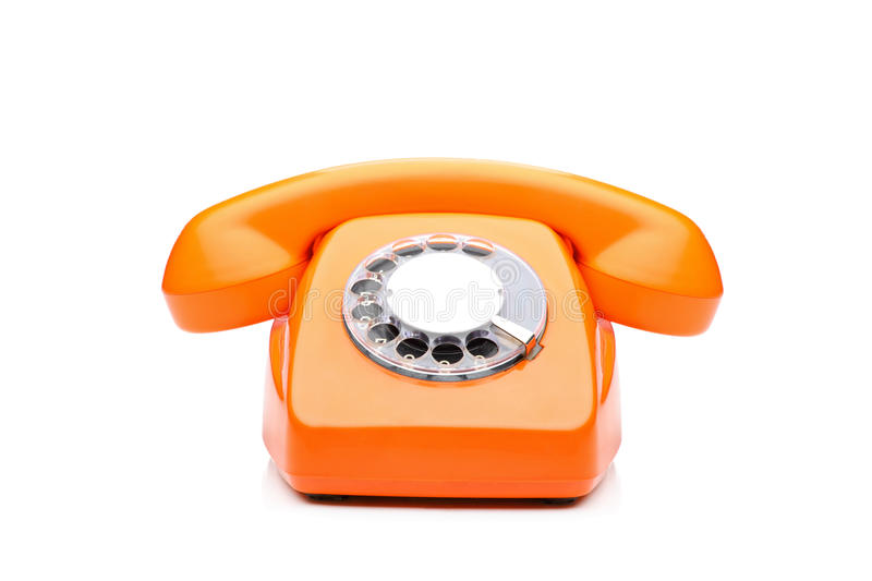 Ein altes orange Telefon stockbilder