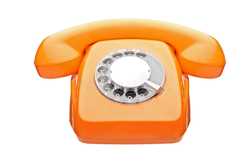 Ein altes orange Telefon stockfotografie