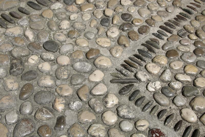 Ein Bild einer netten Kopfsteinsteinhintergrundweinlese-Pflasterungsfliese stockbild