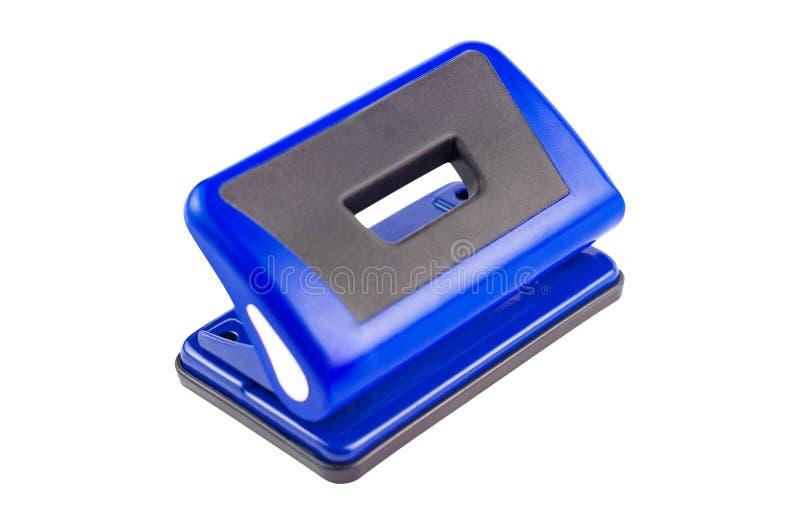 Ein blauer metallischer Locher lokalisiert auf wei?em Hintergrund Beschneidungspfad - Bild stockfoto