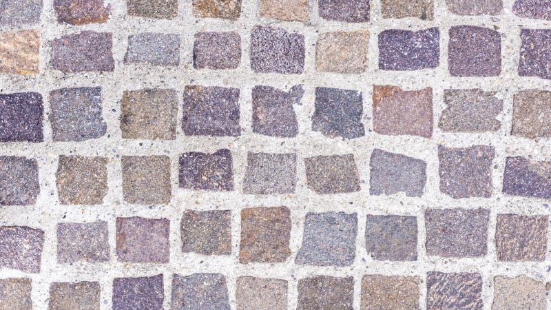 Ein Bodenbelag mit bunten Pflastersteinen stockfoto