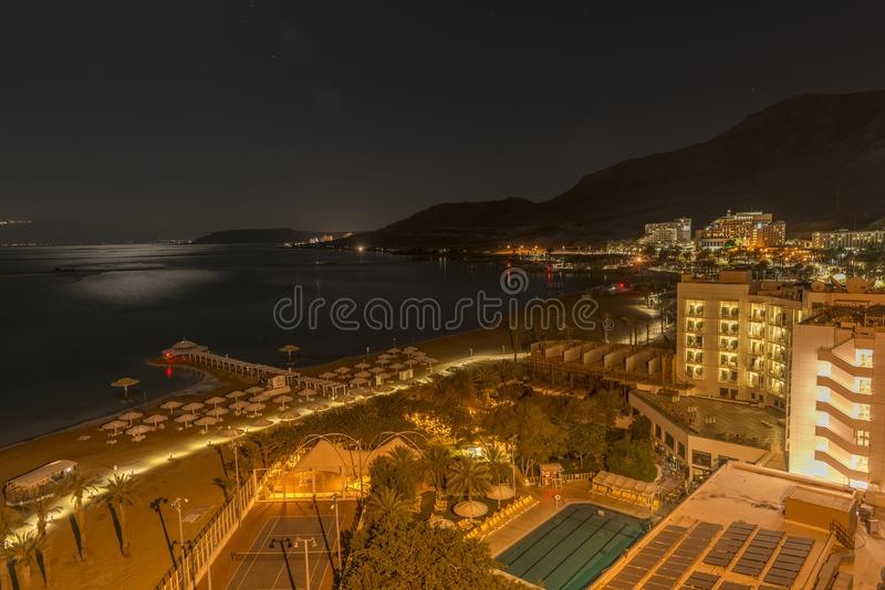 Ein Bokek hotel shore in the dead sea at night royalty free stock photos