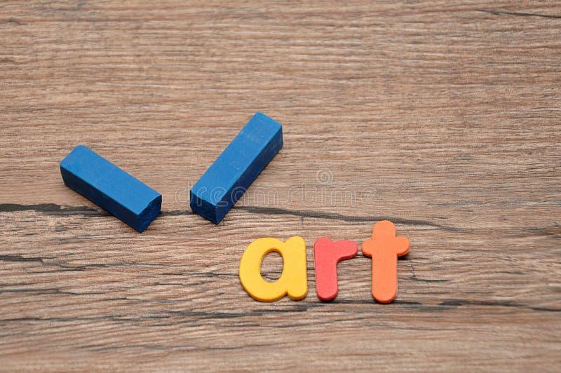Ein defekter blauer Pastell mit der Wortkunst lizenzfreie stockfotografie