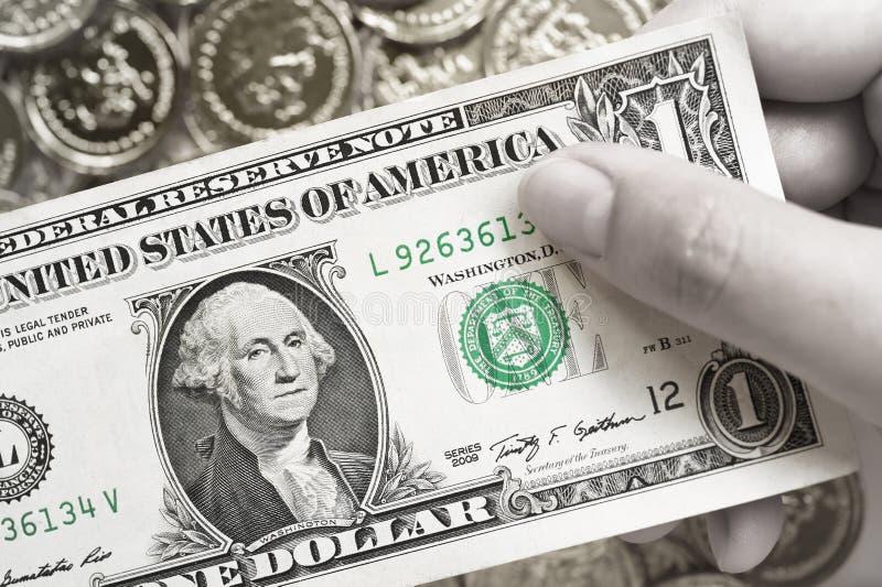 Ein Dollar für Hintergrund stockbilder