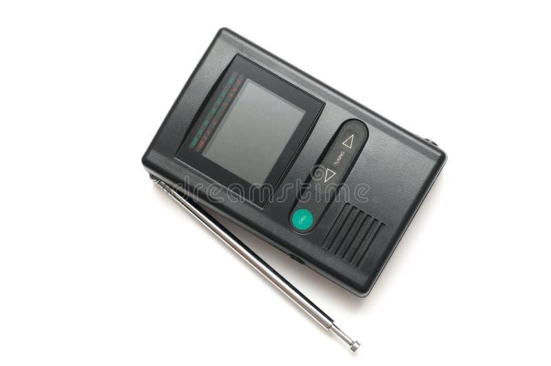 Ein dunkelgraues analoges Portable Fernsehen mit einziehbarer Antenne und kleinem Bildschirm lizenzfreies stockfoto