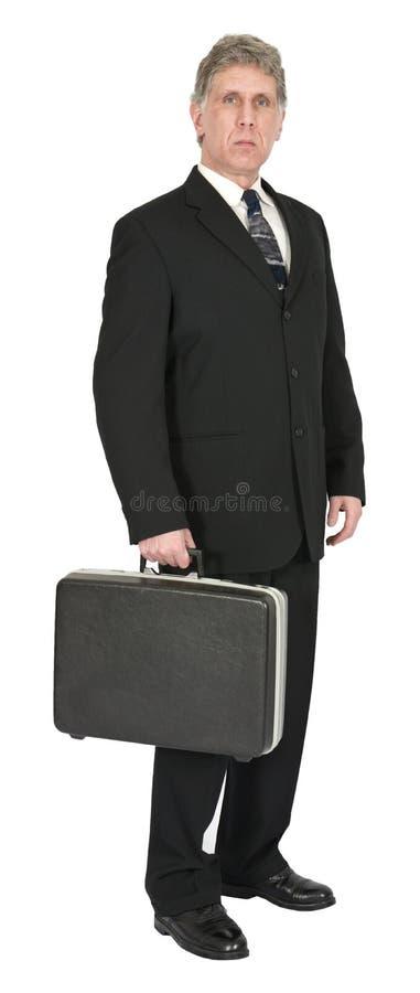 Ernster Geschäftsmann mit dem Aktenkoffer, lokalisiert auf Weiß lizenzfreie stockfotos