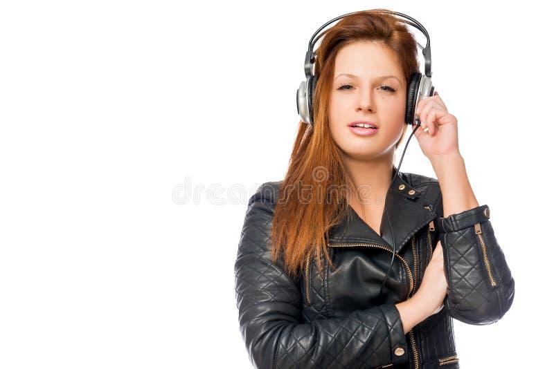 Ein Fan des jungen Mädchens der Rockmusik lizenzfreie stockbilder