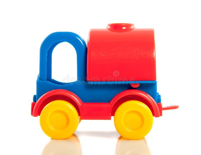 Ein farbiges Spielzeugplastikauto stockbilder